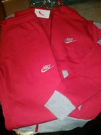 Red and gray 2 pice Nike sweat suit