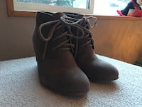 pair of brown suede lace-up boots