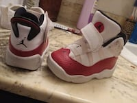 pair of white-and-red Nike basketball shoes Omaha, 68134