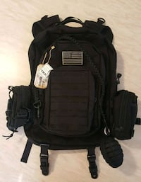 Backpack with lots of removable pouches and acc. Medford
