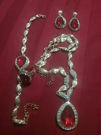silver necklace and bracelet with ruby gemstone