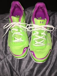 Pair of green-and-pink nike running shoes