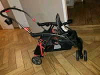 baby's black and red stroller 930 mi
