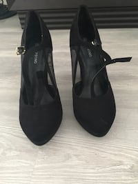pair of black suede ankle strap heeled sandals