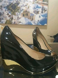 Marciano heels size 7 gold and black  Mississauga