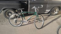 green and chrome hardtail bicycle