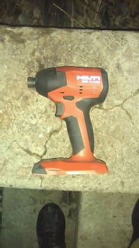 red and black Milwaukee cordless impact wrench Milwaukee, 53207