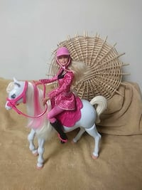 Barbie riding horse figurine with horse