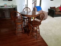 round brown wooden table with four chairs dining set Washington, 20001