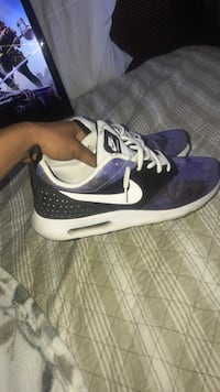 pair of purple-and-white Nike running shoes Bakersfield, 93313