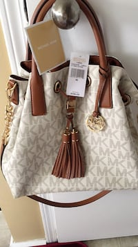 brown and white leather tote bag Calgary, T3J 2X2