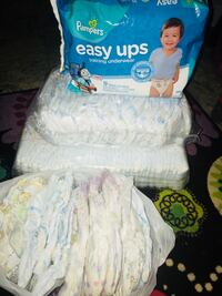 2 packs of size 6 pampers with a pack of 5t pull ups and and extra bag of mix size size 6 diapers and 5t pull ups Woodbridge, 22193