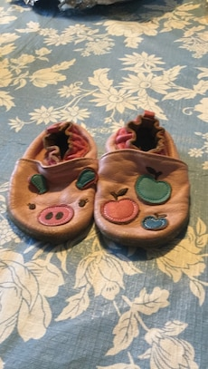 Pair of pink piglet leather slippers