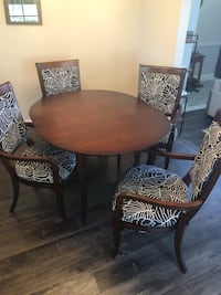 Round brown wooden table with four chairs dining set Moraga, 94556