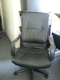 Black leather padded rolling armchair Vancouver, V5T 1P7