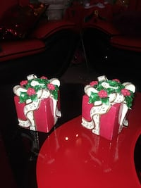 two red gift boxes with ribbons