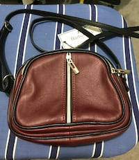 Small black and maroon purse.  Parkville, 21234