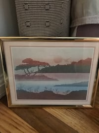 White and brown wooden framed painting of house