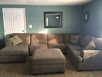 black fabric sectional sofa with throw pillows Plainfield, 46168