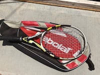 red and black Wilson tennis racket with case