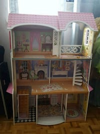 brown, pink, and white 3-story dollhouse 622 km