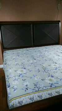 King size leather wooded bed with mattress and box