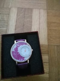 round white and pink analog watch with purple strap