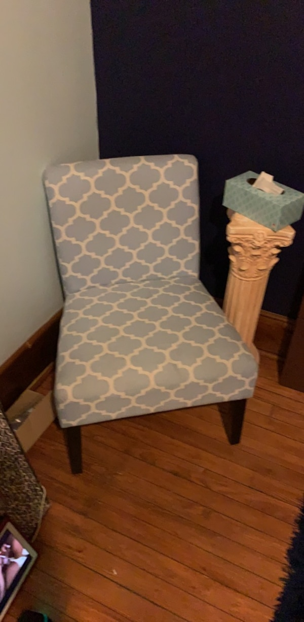 White and gray floral padded chair