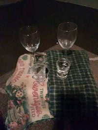 2 wine glasses 2 shot glasses and 2 placemats  Afton