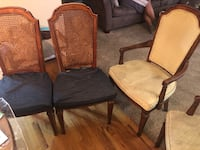 One brown wooden framed padded armchairs. They are still available.