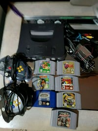 black Nintendo 64 console with controllers and game cartridges Winnipeg, R2K 1V9