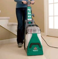 green and black Bissell upright vacuum cleaner Tallmadge, 44278