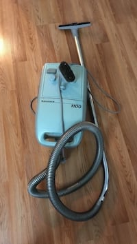teal and black canister vacuum cleaner