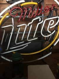 Red and white miller lite neon signage