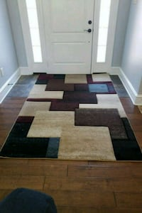brown, black, and white area rug Sherwood