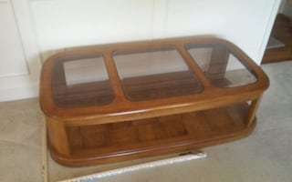 Coffee table: brown wooden frame, one small glass piece missing