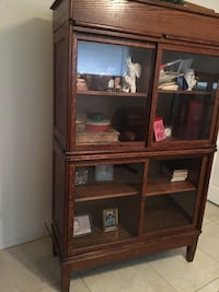 brown wooden framed glass display cabinet Houston, 77036