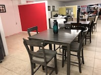 rectangular brown wooden table with four chairs dining set Houston, 77084