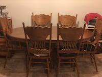 oval brown wooden dining table with chairs set Manassas, 20110
