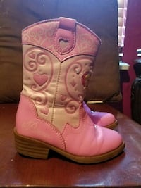 pair of pink leather cowboy boots