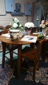 round brown wooden table with four chairs dining set Navarre, 32566