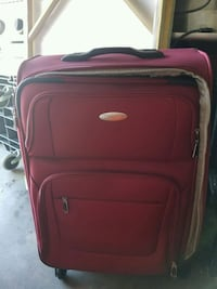 red and black softside luggage