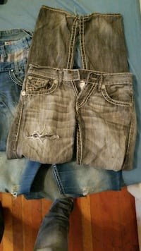 two pairs of brown and blue denim bottoms