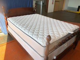 Beautiful antique full size bed with a great mattress set