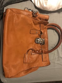 Used michael kors hamilton tote, there are marks on the purse that are pictured. you can't really see them in real life, they kind of blend in with the brown. originally purchased for 400 + taxes so the price reflects current state!