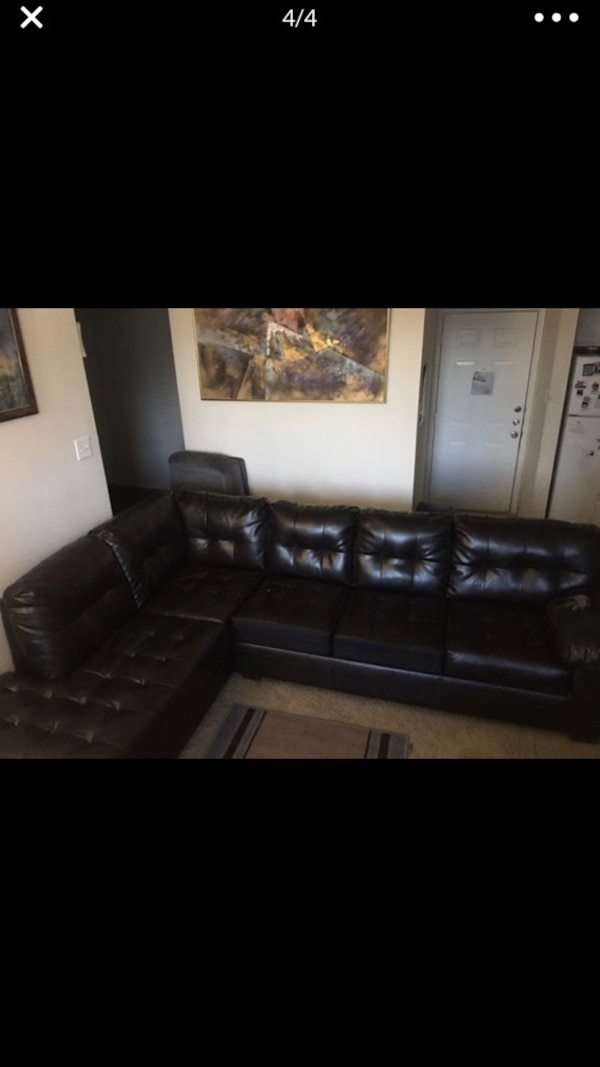 Brown leather L shaped couch