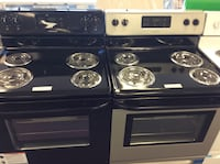 two black and gray 4-coil range oven