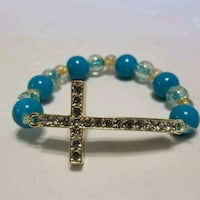 women's teal and white beaded bracelet with silver-colored cross pendant Hot Springs, 71901