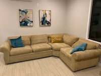 brown suede sectional sofa with throw pillows New York, 10016
