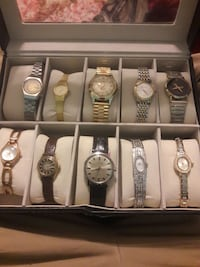 assorted gold and silver analog watches with box